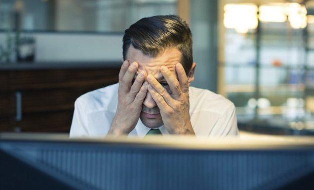 frustrated man at desk