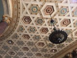 Detail of the ceiling with chandelier.