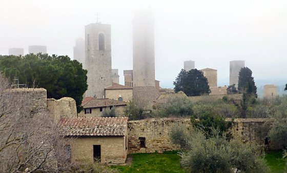 Towers loom in the fog in San Gimignano.