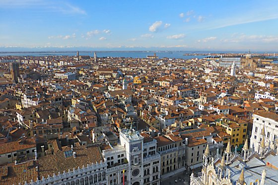 Bird's-eye view of Venice, the Adriatic, and the Alps in the distance.