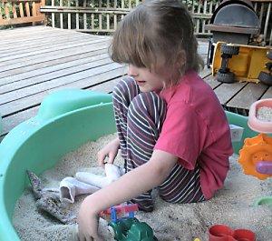 Jillian in the rice sandbox
