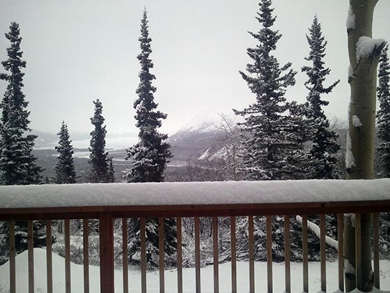 Fresh snow on the deck, mountains, and glacier.