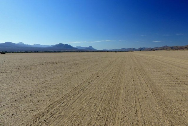 Wide, flat sand road.