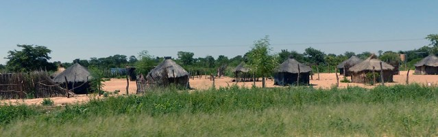 Huts in a fenced compound in Namibia.