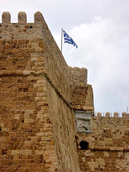 Greek flag at Venetian fortress, Heraklion, Crete, Greece - Jen Funk Weber