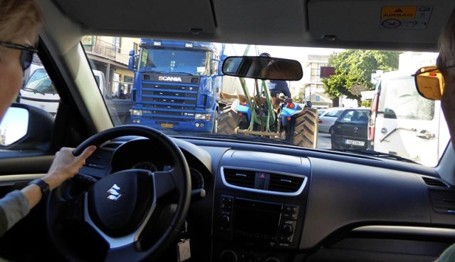 Crowded town street with tractor and truck, driving on Crete - Jen Funk Weber