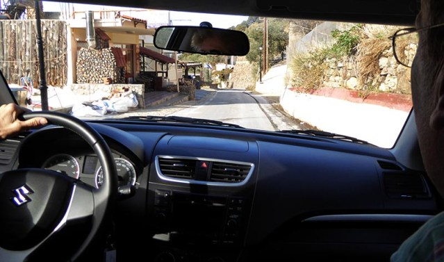 Houses on road, driving on Crete - Jen Funk Weber