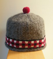Dicey Highland Cap https://jenjoycedesign.com/2014/12/02/a-tall-stack/