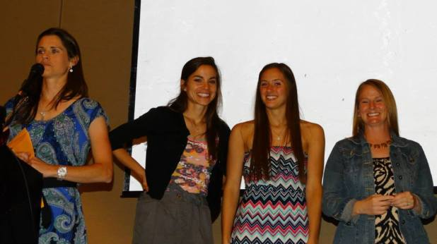 Senior Caroline Frank with Coach Reinhardt, Coach Brady and Coach Foreman.