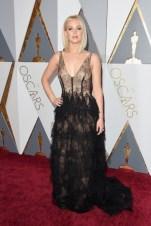 Jennifer Lawrence. Vestido por Dior Haute Couture, jóias por Chopard.