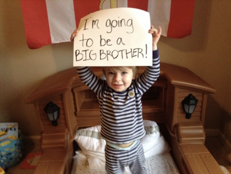 Asher announcing he's going to be a big brother, but not yet knowing it's a twins pregnancy.