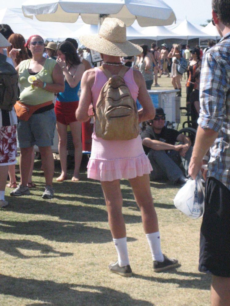 Coachella guy wearing pink dress