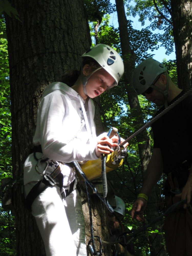 Micaela preps for her first zipline experience.