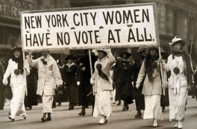 "Shows women marching for the vote. Women were oppressed by ""men,"" rather as is T sexuality oppressed by a gender umbrella."