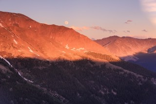 The June full moon rises above the Collegiate Peaks as viewed from Independnece Pass.