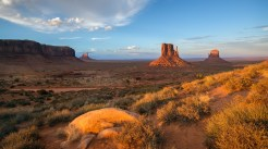 The last light of the day strikes the iconic Mittens of Monument Valley.