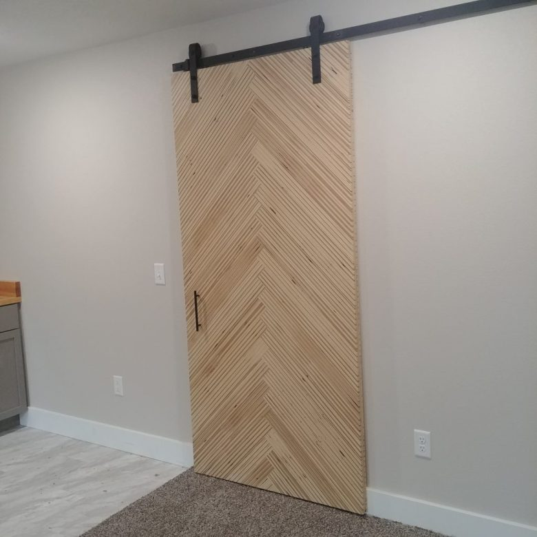 This is the finished modern sliding barn door after it was installed in the new townhome.