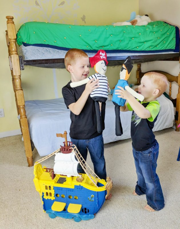 kids playing with stuffed pirates