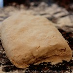 Dust surface of dough with flour; with floured hands, knead dough 6 to 8 times, until it just holds together in ragged ball, adding flour as needed to prevent sticking.