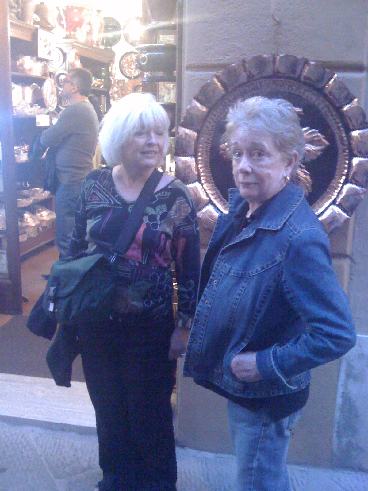 Susan and Nan pause in front of my favorite shop where they sell homemade copper pots