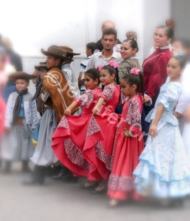 posing for pictures in traditional dress after a folk festival in Buenos Aires