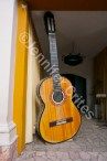A giant guitar stands guard at a building entrance in the city of Salta.
