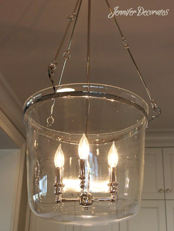 Until I saw this, I had never thought about using lanterns for bathroom light  fixtures. But, I really like these!
