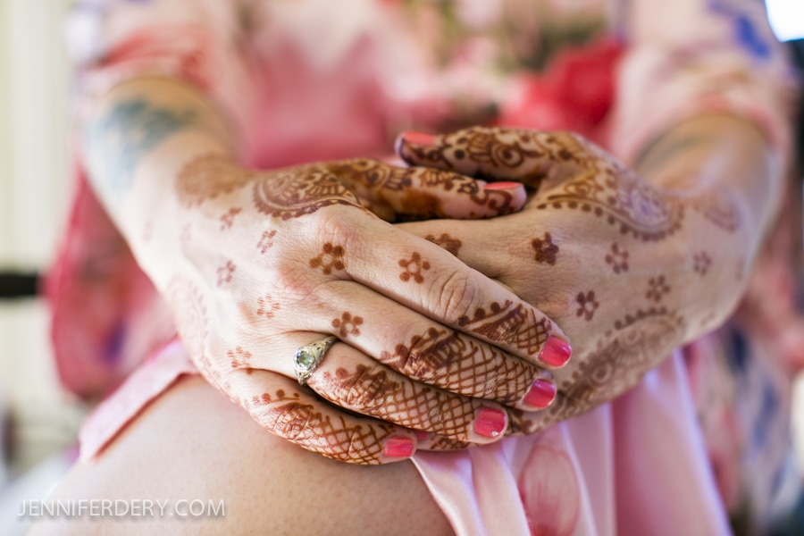 photo mehndi on hands at a non-indian wedding