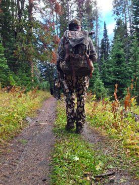 Photo of a bow hunter walking, elk.
