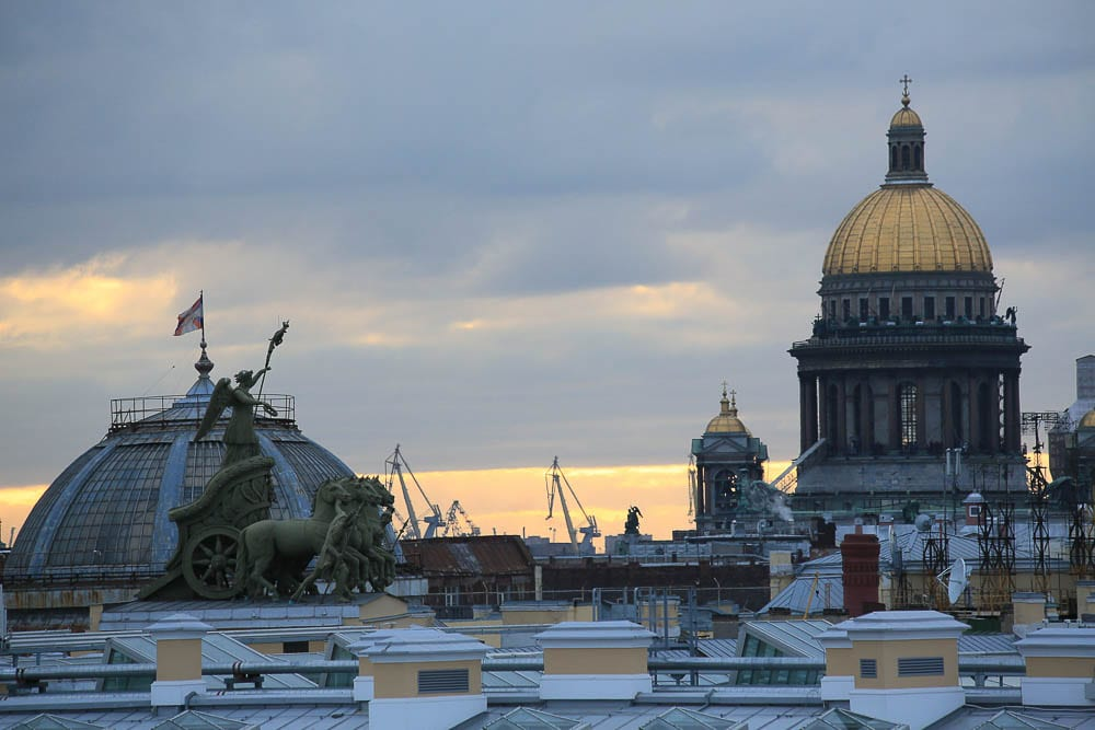 An unusual view of the rooftops of St. Petersburg, including the large dome of St. Issac's Cathedral and the quadriga of the General Staff building.