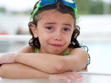 crying swimmer girl