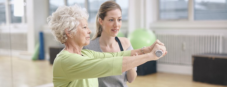 Older woman weight training