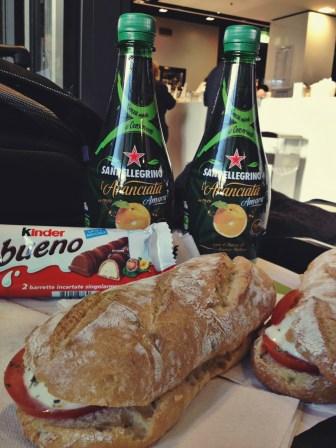 Lunch of Caprese paninis, pellegrino, and a bueno bueno
