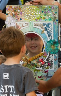 Johnathan Fournier looks at his Spiderman face paint at Riverfest.