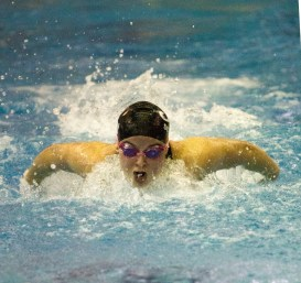 Fenwick high school senior Erin Scudder swims heat 3 of the 100-yard butterfly during the IHSA Girls Sectional on Saturday, Nov. 14, 2015