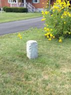 We saw two more Bedford-Stoystown Turnpike markers during our road trip, The one pictured here is located along the Lincoln Highway on someone's lawn! We also saw one more on Route 30 but there was too much traffic to stop and snap a picture. (Photo by Jennifer Sopko)