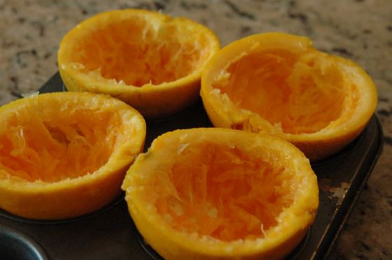 muffin tin and empty-bodied oranges