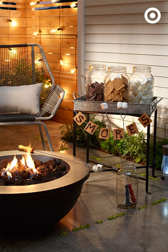 Smores Station (11 Ways to Impress Guests at Your Outdoor Party! via @jennyonthespot)