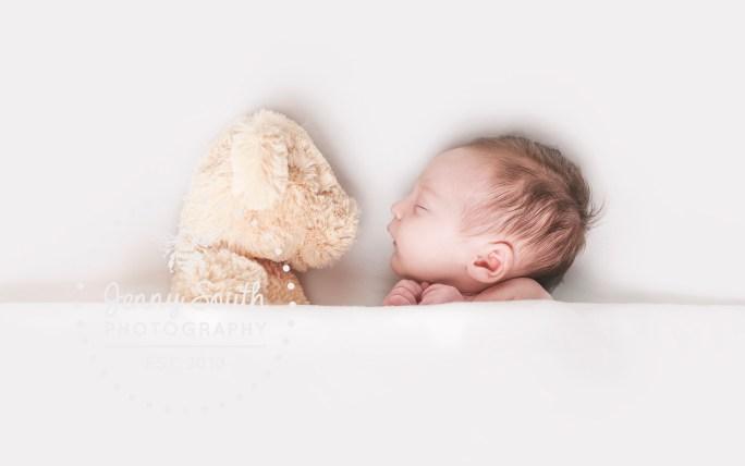 Newborn baby boy with his teddy bear