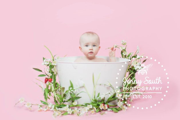 Baby girl in spring time bath