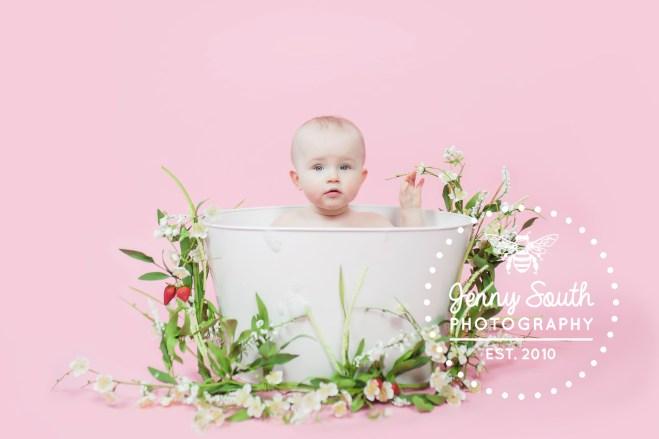 Baby girl in spring time bath