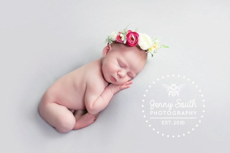 Newborn baby girl in floral flower crown