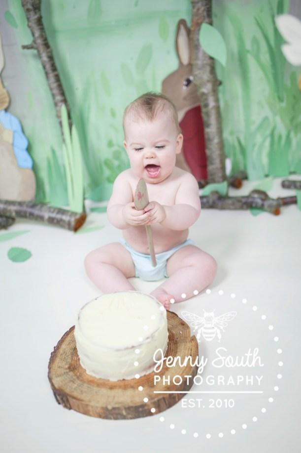 Baby boy enjoying his cake smash session