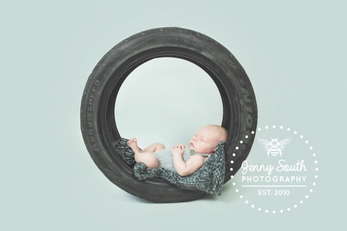Newborn Baby asleep in a tyre during his newborn session