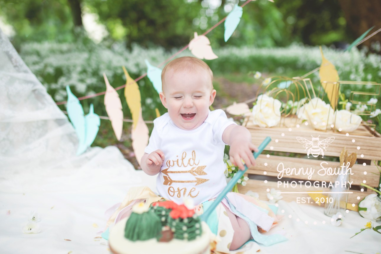 Baby girl during an outdoor cake smash in the plymouth sunshine