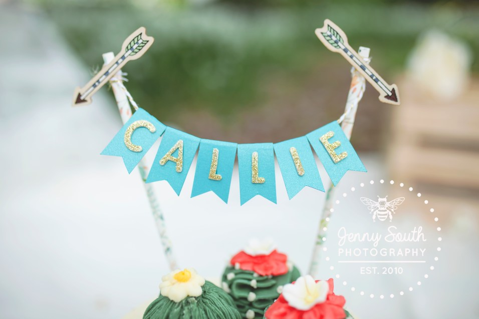 beautiful handmade cake topper on top of naked cake with added cactus