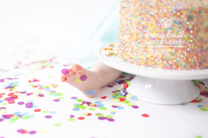Tiny toes covered in confetti during a cake smash session in our Devon studio