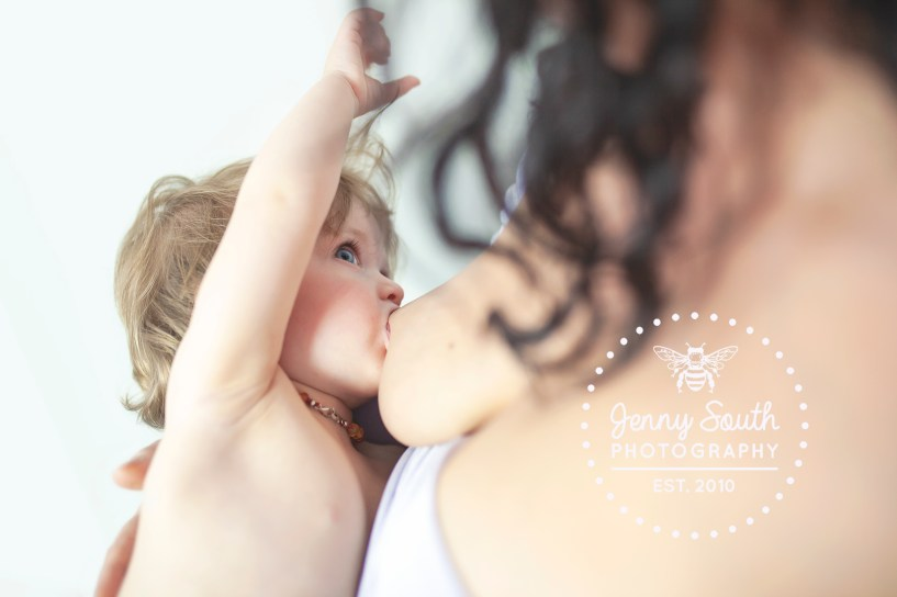 Breastfeeding baby and mother in a photography session in Plymouth