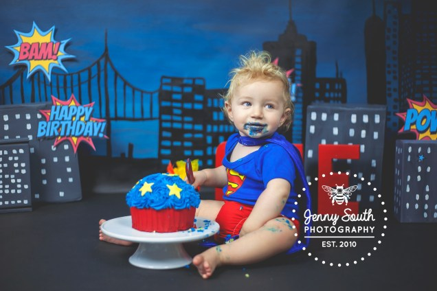 Superman theme cake smash for a baby boy in our plymouth photography studio