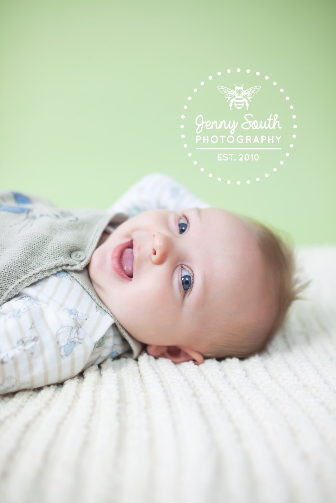 Photo of a baby giggling during a photo shoot in Plymouth